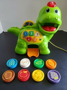 VTech Chomp and Count Dino 8 coins Teaches Shapes Numbers Colors Pull Along Toy #VTech Toddler Toys, Baby Toys, Pull Along Toys, Teaching Shapes, Animal Puzzle, Puzzle Toys, Childhood Toys, Learning Toys, Vintage Disney
