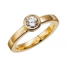 Elegant förlovningsring/vigselring i 18k guld från Schalins i serien Tropic. Ringen har en diamant på 0,50ct Wesselton VS. Ringen är 3mm bred och 2,4mm hög.