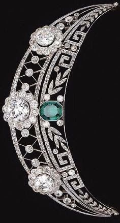 EMERALD AND DIAMOND TIARA, CIRCA 1910 The upper tier of open work trellis design millegrain-set throughout with rose diamonds, and decorated with three flower head cluster motifs set with circular-cut diamonds, the lower tier of foliate and meander. Royal Crown Jewels, Royal Crowns, Royal Tiaras, Royal Jewelry, Tiaras And Crowns, Bling Jewelry, Jewelery, Jewelry Necklaces, Bullet Jewelry