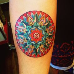 Costa Rican ox cart wheel, thanks again George.  (at scapegoat tattoo) - I'd like something similar, but bigger and on my back