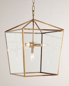 "Lantern works exceptionally well in multiples over a bar or table. Made of metal and glass. Soft-brass finish. 16.25""Sq. x 24""T with 6'L chain and 5""Sq. ceiling canopy. Uses five 60-watt bulbs. Direct"