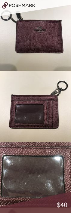 Coach card holder / coin purse Maroon pebbled leather coach card holder with zipper compartment for coins. 3 slots for card and ID.  Hardware and plastic covering for ID compartment has minor scuffs or scratches from use. Coach Accessories Key & Card Holders