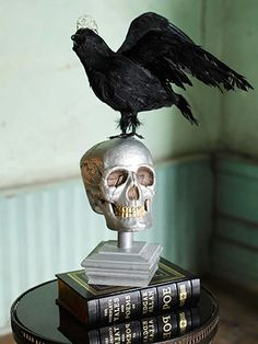 This smile is one only a mother could love -- the mother of Frankenstein, that is! This silver skull makes a perfect perch for a creepy raven that flaunts a miniature tiara.