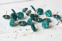 Why have I never thought of this? Paint your dull metallic pushpins sparkly for an extra punch of color.