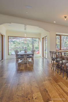 Wide Plank Hand Scraped Hickory Hardwood Floor By Oak And Broad | Dining Area And Kitchen Bar Showing Unique Rustic Architecture | Discover more at http://OakAndBroad.com/custom-hand-scraped-hickory-floor-cupertino/