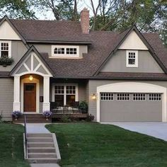Love these exterior colors... Brown roof with Gray and cream house colors