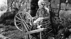 Old photograph of a crofter spinning wool outside her cottage in Portnalong, Isle of Skye, Scotland
