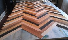 Something like this for sofa table!!!  of wood to make herringbone table pattern