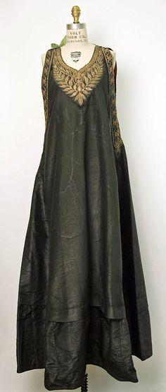 Dress    Date:      19th century  Culture:      Algerian  Medium:      silk, cotton, metal thread