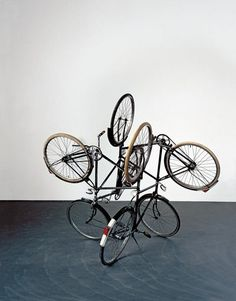 Gabriel Orozco. Four Bicycles There is Always One Direction, 1994. Sculpture using four bicycles with the wheels all pointing in different directions. Tate Modern.