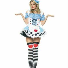 Miss Wonderland costume bundle Super cute Alice in Wonderland costume worn once great condition all pieces bought separately selling as a bundle that includes dress, wig, clock bag, black & white striped thigh high tights & arm warmers... Dresses