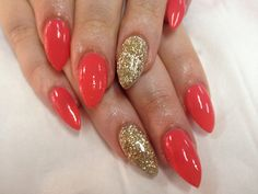 Coral gels with gorgeous glitter feature nails