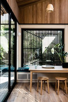 Great window seat and screen. | Light Corridor by FIGR Architecture & Design