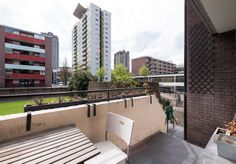 Golden Lane Estate, EC1, with towers of the Barbican in the background