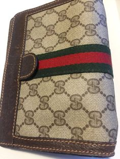 Vintage Gucci GG canvas red green strip clutch https://www.etsy.com/listing/579321534/gucci-vintage-mini-clutch-gg-canvas-and