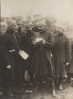 WW1: Officers of 1.Ukrainian Division read battle orders. Note the elaborate astrakhan hats. In the Tsarist army, all nationalities fought under one flag but were allowed to wear uniforms with distinctly ethnic details. The Anne S. K. Brown Military Collection.