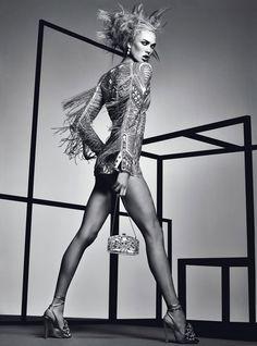Karlie Kloss models the season's most electrifying, energizing, eye-popping fashion.