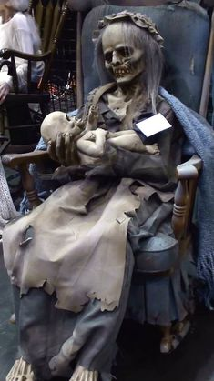 Lullaby Animated Rocking Prop. This skeletal old woman rocks her skeletal baby, humming a lullaby the entire time (see video). Part of the Frightronics line, this heavy duty animated prop will run all day long! Solid steel motor with foam and latex body - this is built to last. Sculpted by Jordu Schell with incredible detail.