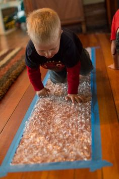 a Bubble Wrap Runway for Kids of All Ages Next time I get bubble wrap -- tape it down to the floor for a fun runway!Next time I get bubble wrap -- tape it down to the floor for a fun runway! Gross Motor Activities, Infant Activities, Preschool Activities, Baby Activities 1 Year, Children Activities, Baby Sensory Play, Baby Play, Sensory Art, Infant Classroom