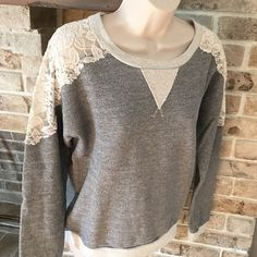 Target xhilaration lace sweatshirt grey top Pretty and girly lace sweatshirt! Floral lace detail on shoulders and back. Worn once and in excellent condition. 70% cotton - 20% polyester and 10% rayon. Xhilaration Tops Sweatshirts & Hoodies