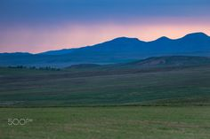 violet mountains silhouettes - Beautiful rain sunset in fields with mountains view on horizon in Kazakhstan, Central Asia