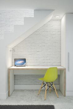 Insert a study. If you desperately need a home study area, then utilizing the understairs zone may work better for you than sacrificing a corner of the bedroom or dining room. Remember to think about functional things, such as lighting, as the area under the stairs can be pretty gloomy. Here, strategically placed spotlights ensure that the owner won't be working in the dark. Modern Home Office by Custom Desk