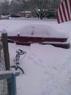 Wichita Kansas 2013 February.@  my son's house looking outside!  His bicycle almost buried completely in the snow.