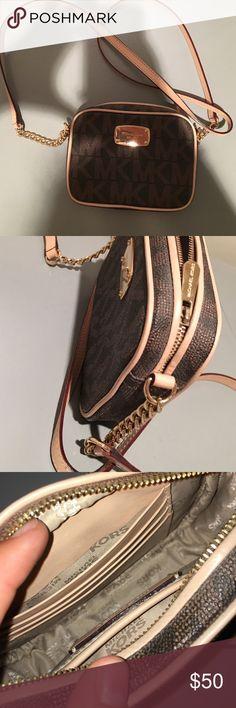 Michael kors cross body purse Mk print in brown. Great condition Michael Kors Bags Crossbody Bags