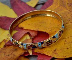 Vintage Gold Tone Bangle Bracelet, Red, Black, Aqua and White Enamel, EX!  | eBay http://www.ebay.com/itm/Vintage-Gold-Tone-Bangle-Bracelet-Red-Black-Aqua-and-White-Enamel-EX-/112198544844