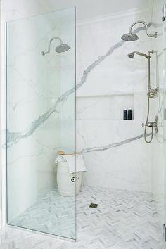 Marble herringbone shower floor tiles