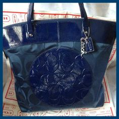 9a2ccd82ed12 'Coach NWT Laura Nylon Tote Navy' is going up for auction at 1pm Mon, Oct  21 with a starting bid of $1.