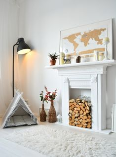 Dog teepee tent by Dog&Teepee in white scandi interior with fireplace. Dog & Teepee - more than just dog bed. We've created a space that your fur babies will love calling home.