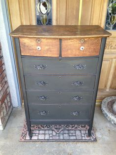 Black, chalk painted, mildly distressed dresser with natural wood accent top drawers and top shelf. #peachyperchfurniture
