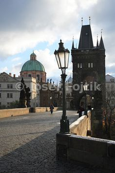 Charles Bridge. Dome of the Church of Saint Francis Seraph on the left and Old Town Bridge Tower on the right, Prague, Czech Republic