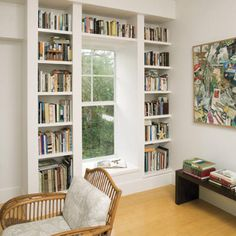 similar to this only leave above the window free, a cushioned seat, and closed cupboards below the bookshelves.