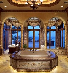 This looks like a bathroom that would be out of a movie, something like The Gladiator with a king or someone being pampered, the room is huge.
