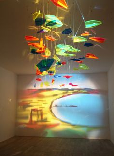 """uses glass and other materials to create wall """"paintings"""""""