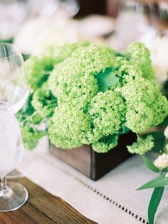 Green Centerpiece - Viburnum? On http://www.StyleMePretty.com/2014/03/31/celebrity-stylists-wedding-at-bedford-post-inn/ Trent & Dara Of Trent Bailey Photography - www.trentbailey.com