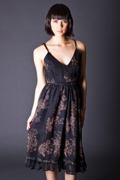 Dark and pretty vintage party dress with a touch of sparkle.