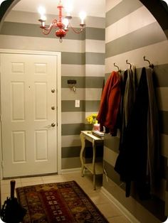 Mud Room....stripes are a great way to make a small room seem much larger
