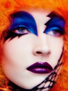 Glam Rock - Extreme and playful eye makeup in royal blue and black paired with dark berry purple lips. #makeup