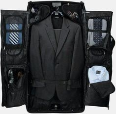 If you're an avid traveler for business then this rolling garment bag is a great option for keeping your gear in order on the road. This garment bag has a concealed hook which allows for easy hanging so you can use it like a. Traje Black Tie, Fashion Bags, Men's Fashion, Travel Fashion, Garment Bags, Estilo Fashion, Casual Styles, Gentleman Style, Well Dressed