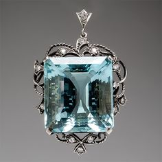 51 carat emerald cut centre stone and diamonds accents. This 1940's pendant is crafted of solid 14k white gold
