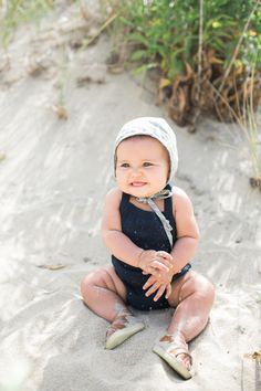those rolls <3 sweet black swimsuit and sunhat for bubba