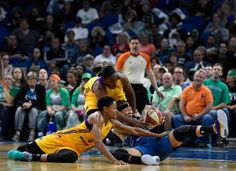 Alana Beard #0 and Chelsea Gray #12 of the Los Angeles Sparks go after a loose ball with Seimone Augustus #33 of the Minnesota Lynx during the fourth quarter in Game Two of the 2016 WNBA Finals on October 11, 2016 at Target Center in Minneapolis, Minnesota. The Lynx defeated the Sparks 79-60.