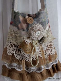 Large handbag made with thick, soft floral and gold fabrics and vintage crochet pieces. Ruffles throughout the front body with vintage doilies,