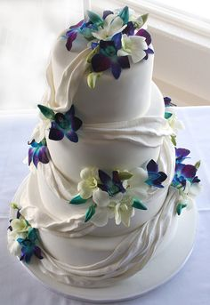 blue orchid drape wedding cake