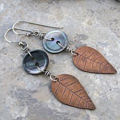 Buttons with Leaves Earrings by Mary Newton   Artist Statement:  I cut and stamped these bits of copper to simulate leaves. Then I attached ...
