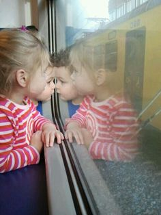 My grandkids in the train to the zoo