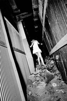 Daido Moriyama, Untitled (woman in white dress running), 1971